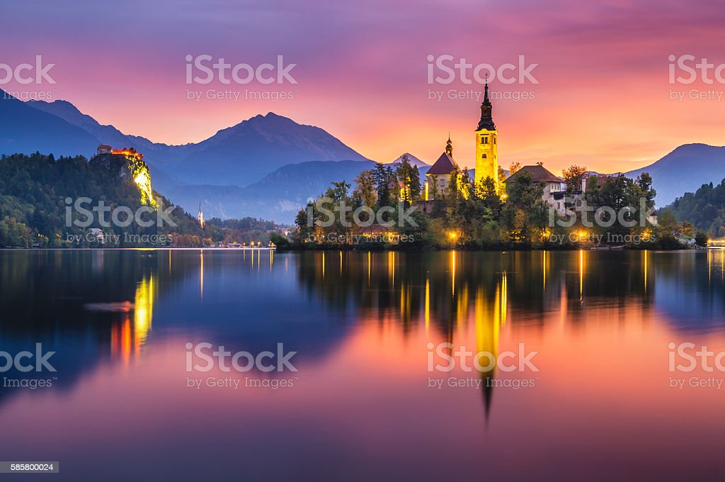 beautiful, multicolored sunrise over an alpine lake Bled in Slovenia stock photo