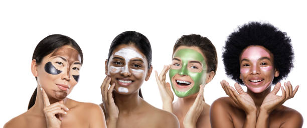 Beautiful multi-ethnic group of girls with colorful peel-off masks on their faces stock photo