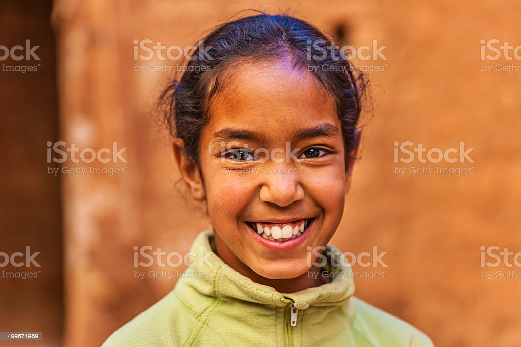 Beautiful Muslim girl in Moroccan kasbah stock photo