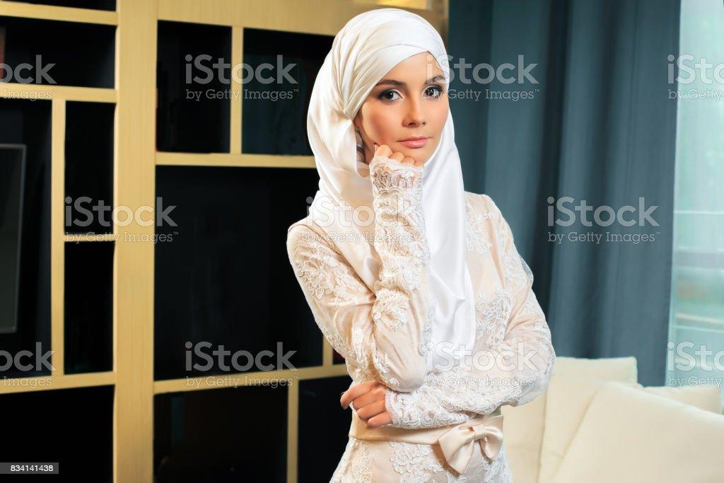 Beautiful Muslim woman in wedding dress stock photo