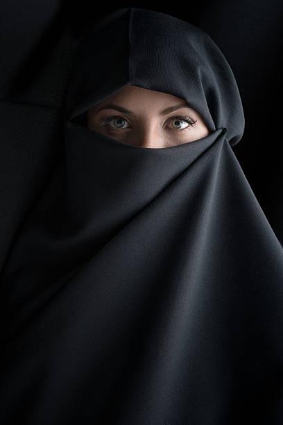 beautiful muslim woman wearing the hijab - burka stock-fotos und bilder