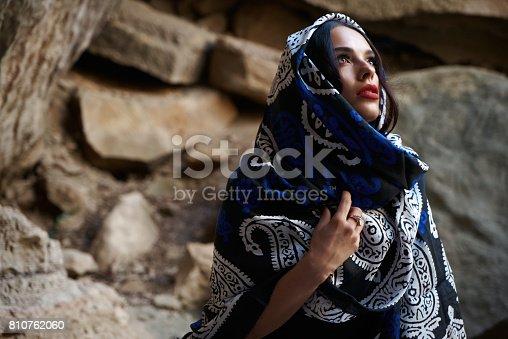istock Beautiful muslim women with scarf. Muslim fashion model with oriental colorful shawl on head. 810762060