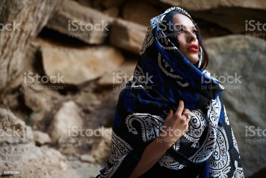 Beautiful muslim women with scarf. Muslim fashion model with oriental colorful shawl on head. stock photo