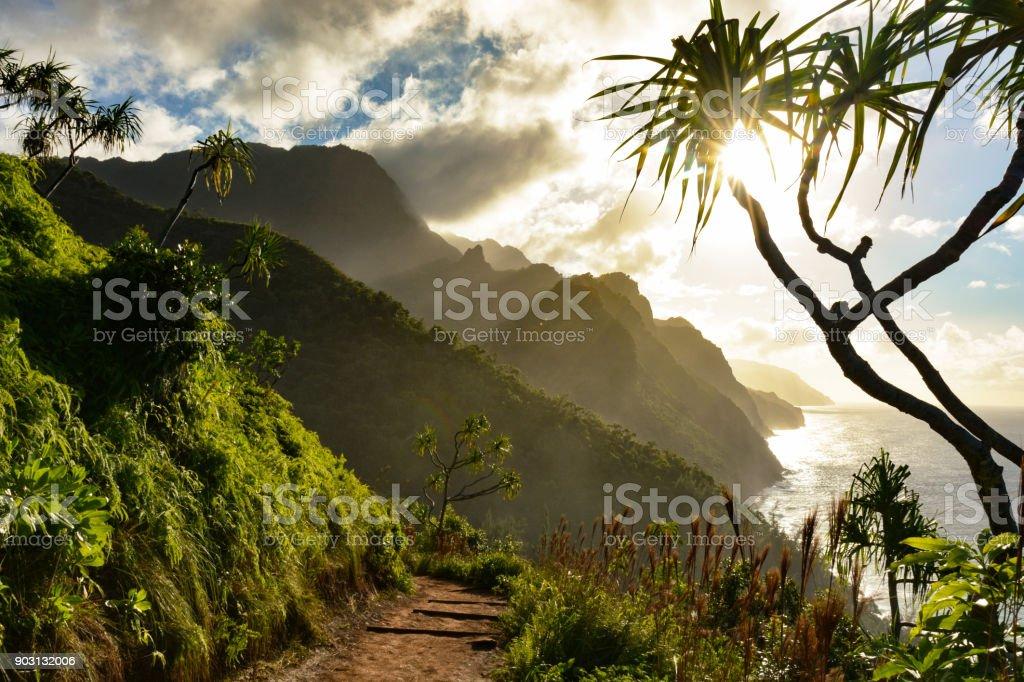 Beautiful Na Pali coast sunset from the Kalalau Trail on Kauai's north shore stock photo