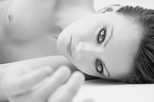 Beautiful Naked Girl Lying On The Floor Stock Photo