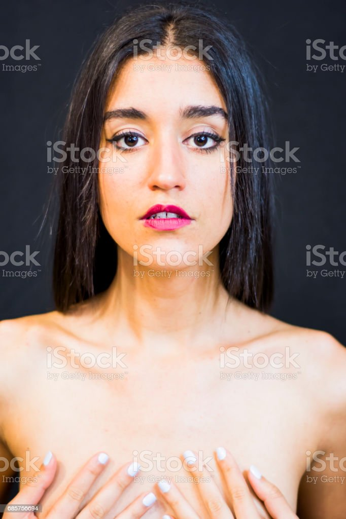 Beautiful naked woman covering her breasts foto stock royalty-free