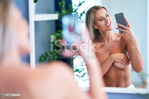 Picture of adult naked woman in the bathroom