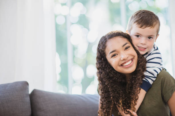 Beautiful nanny and young boy stock photo