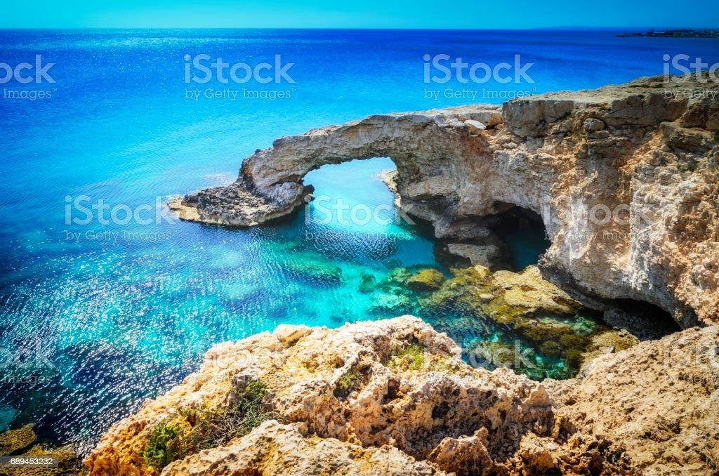 Beautiful natural rock arch near of Ayia Napa, Cavo Greco and Protaras on Cyprus island, Mediterranean Sea. Legendary bridge lovers. stock photo