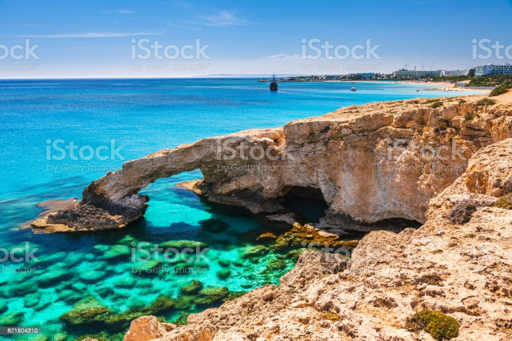 Beautiful natural rock arch near of Ayia Napa, Cavo Greco and Protaras on Cyprus island, Mediterranean Sea. Legendary bridge lovers. Amazing blue green sea and sunny day. stock photo