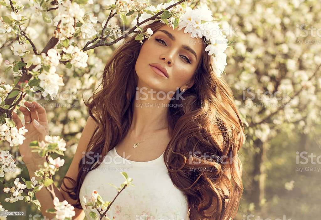 Beautiful natural woman in the garden of apple stock photo