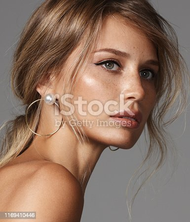 Portrait of beautiful natural woman with earrings