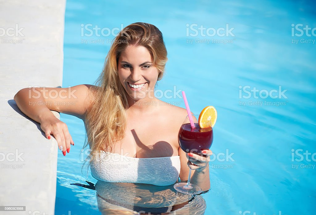 Beautiful natural woman smiling in pool on summer vacations royalty-free stock photo