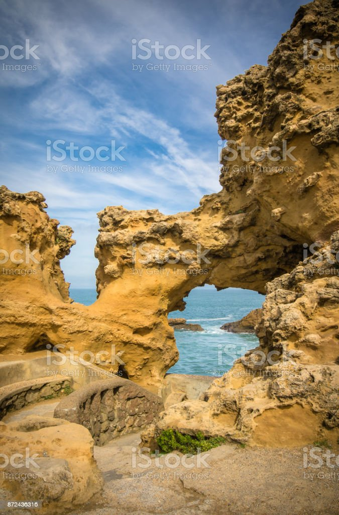 beautiful natural yellow rock formation on atlantic coast in blue sky, biarritz, basque country, france stock photo