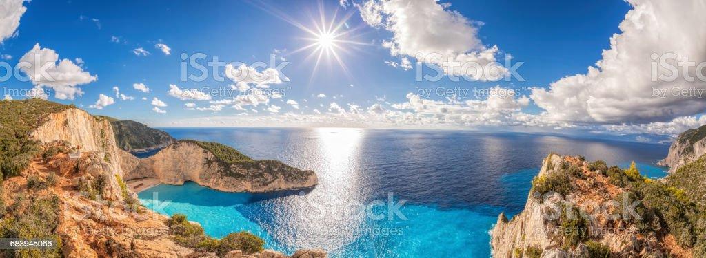 Beautiful Navagio beach with shipwreck on Zakynthos island in Greece Beautiful Navagio beach with shipwreck on Zakynthos island in Greece Bay of Water Stock Photo