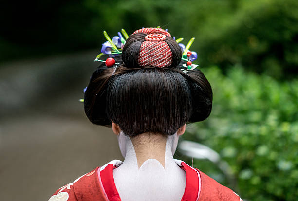 Beautiful neck of a Geisha Beautiful neck of a Geisha in full Japanese clothing and decorated with traditional makeup and hairdo geisha stock pictures, royalty-free photos & images