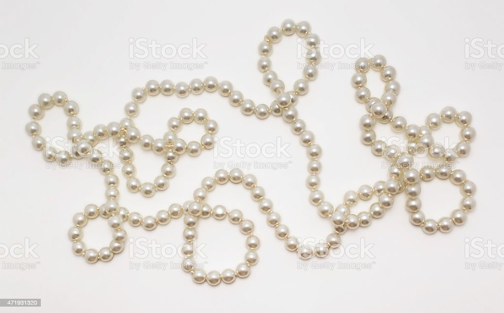 Beautiful necklace made of pearls on white background stock photo