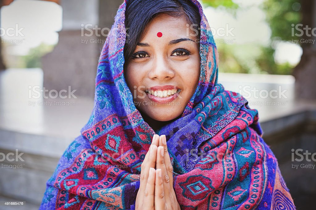 beautiful nepalese woman  performing namaste gesture stock photo