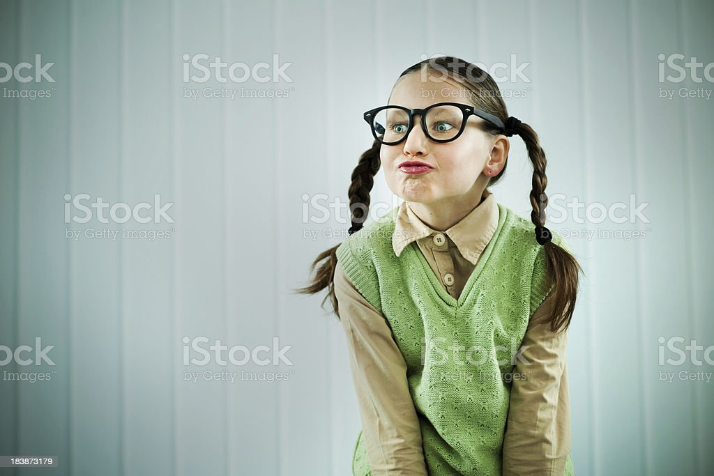 Beautiful Nerd Girl Pouting Her Lips Royalty Free Stock Photo