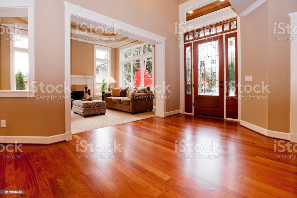 Beautiful New custom Entryway upscale home hardwood floors stock photo