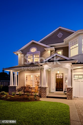 697393252 istock photo Beautiful New England Style Home Exterior at Night 472018064