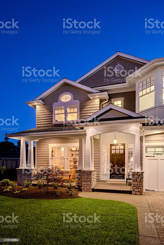 Beautiful New England Style Home Exterior at Night stock photo