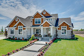 istock Beautiful new home with big front porch and entry 1256023751