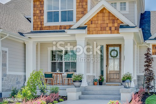 istock Beautiful new home with big front porch and entry 1256023753
