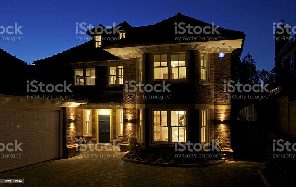 beautiful new house at night stock photo