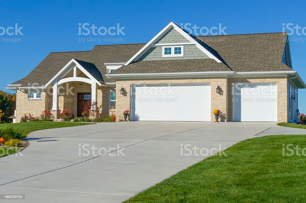 Beautiful New Mixed Materials Ranch Style Home stock photo