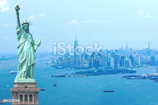 Amazing View of New York City Skyline from a helicopter. Empire State Building, One World Trade Center & Statue of Liberty.