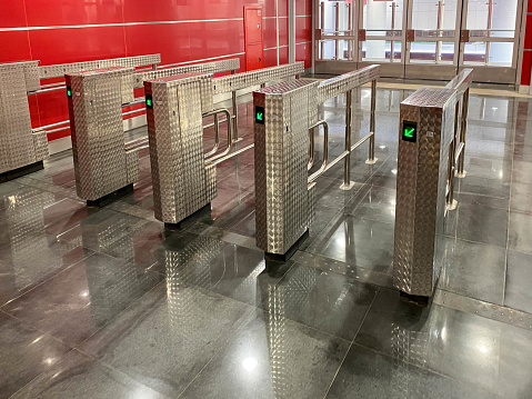 Beautiful new shiny metal automatic turnstiles for entering the subway or exiting the building