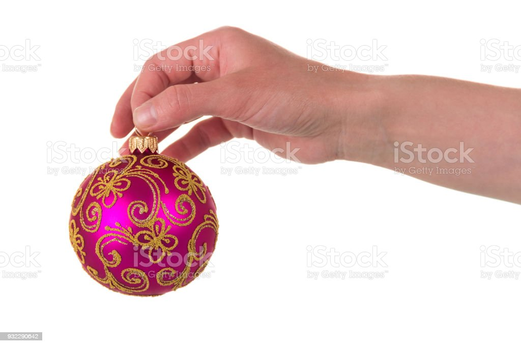 Beautiful New Year ball with patterns in hand, isolated on white stock photo