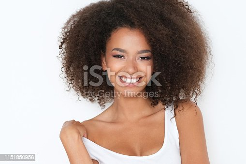 910856488 istock photo Beautiful nice girl with toothy smile, standing in front of camera. 1151850956