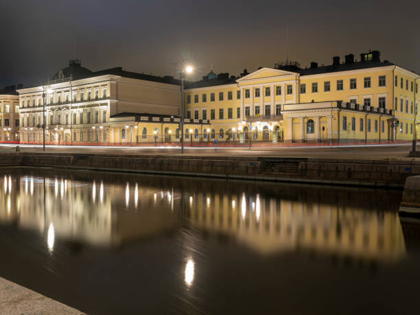 A beautiful night cityscape of the presidential palace of Finnish president in downtown Helsinki. stock photo
