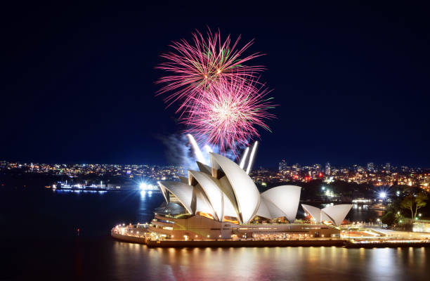 Beautiful night display of colorful fireworks over the Sydney Opera House stock photo