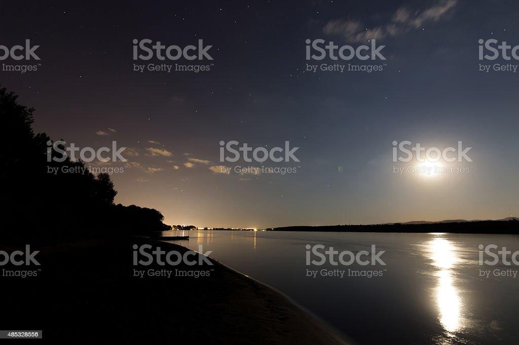Beautiful night sky, city light, moon light with reflection stock photo