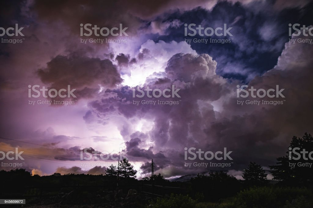 Beautiful night storm in bright colors over Monte San Michele, Italy stock photo