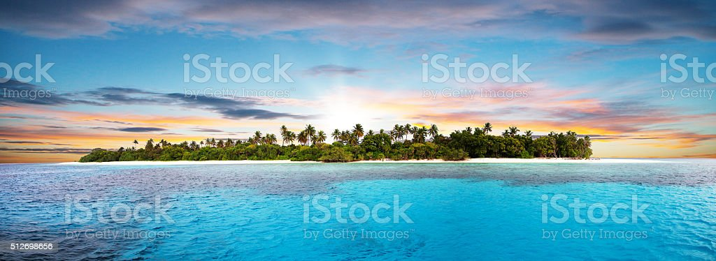 Beautiful nonsettled tropical island in sunset stok fotoğrafı