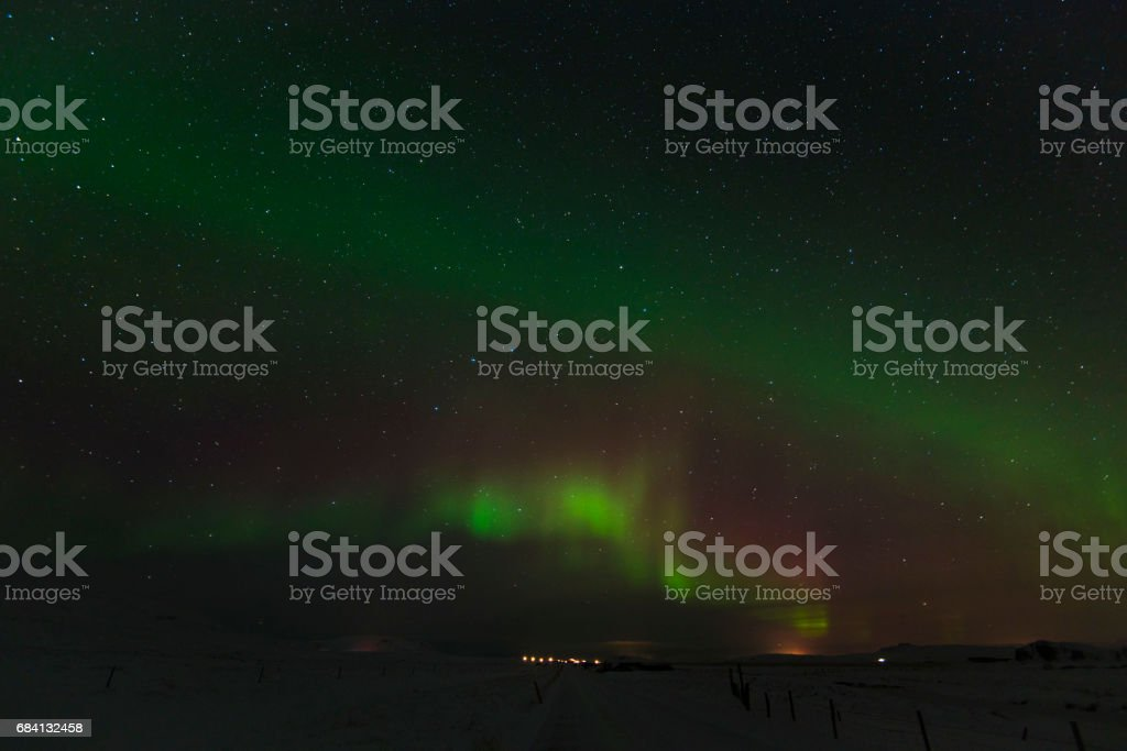 Beautiful Northern Lights in Iceland and starry sky. Excited oxygen and nitrogen glows royaltyfri bildbanksbilder
