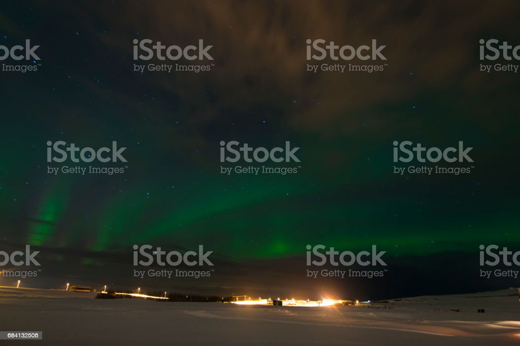 Beautiful Northern Lights in Iceland and starry sky. Excited oxygen and nitrogen glows zbiór zdjęć royalty-free
