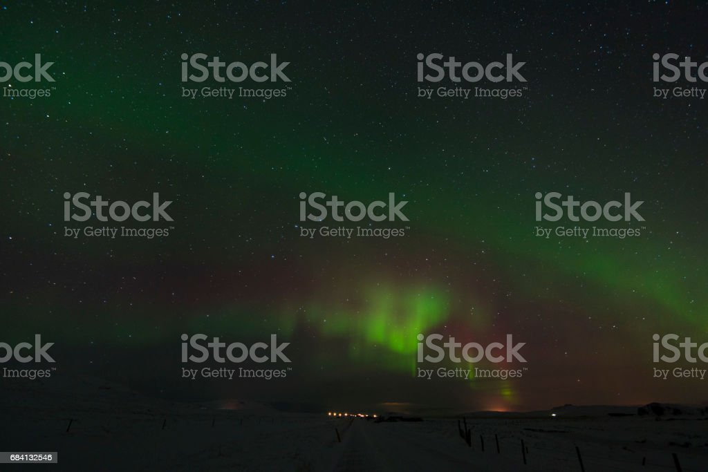 Beautiful Northern Lights in Iceland and starry sky. Excited oxygen and nitrogen glows royalty free stockfoto