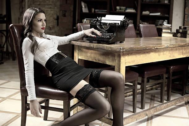 Beautiful novelist daydreaming stock photo