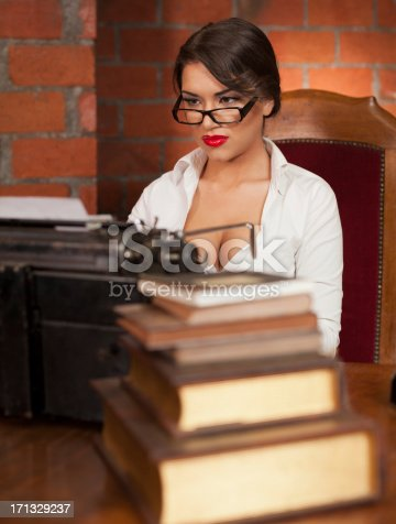 471445335istockphoto Beautiful novelist typing 171329237