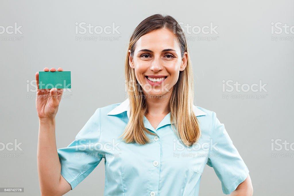 Belle Infirmiere Tenant Carte De Visite Photo Libre Droits