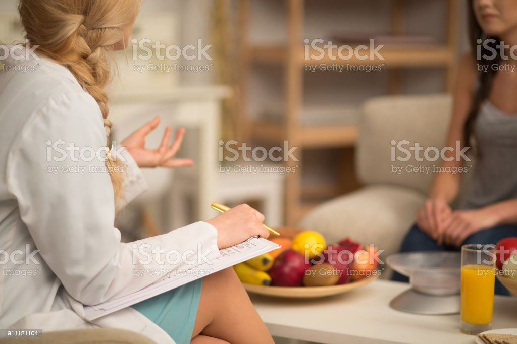 A beautiful nutritionist consult at the office stock photo