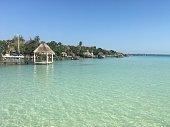 Beautiful ocean view with clean blue turquoise water, sunny day. Amazing background of island, Caribbean, Lagoon Bacalar. Calm secluded place without people, paradise