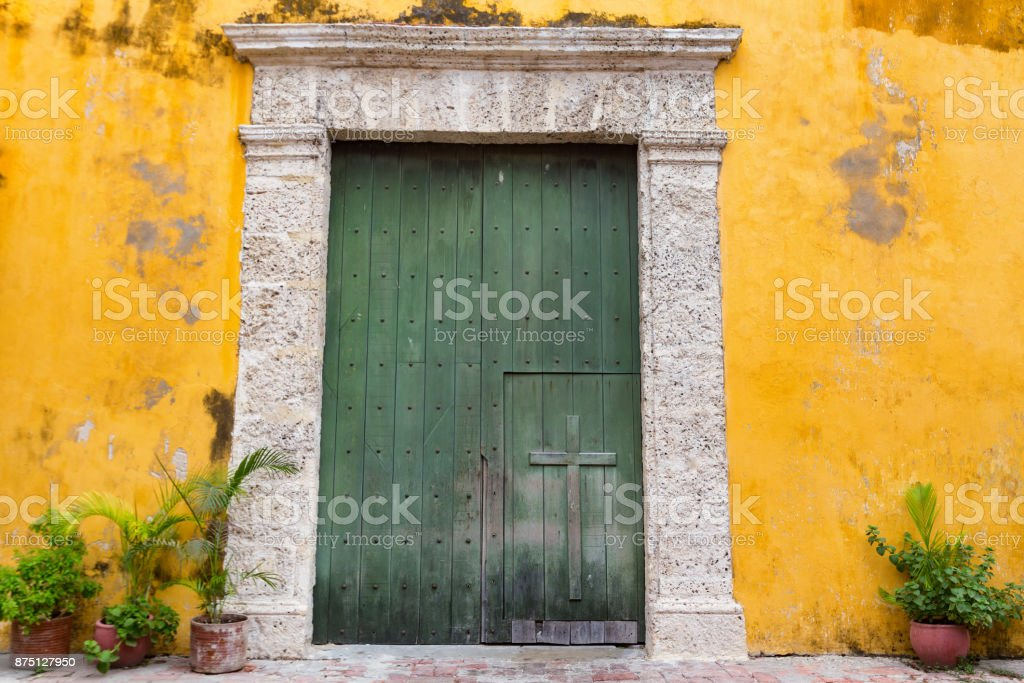 Beautiful Old Colonial Door at the Holy Trinity Church in the Getsemani stock photo