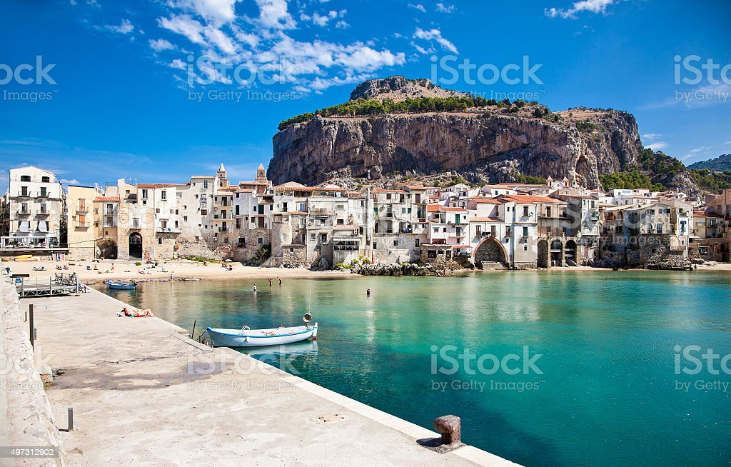 Beautiful old harbor with wooden fishing boat in Cefalu, Sicily stock photo