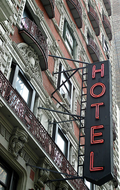 beautiful old hotel with neon sign in New York City stock photo